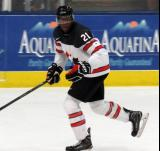 Givani Smith of Team Canada skates up ice during a game against Team USA at the 2017 World Junior Summer Showcase.