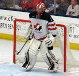 Dylan Wells of Team Canada gets set in his crease during a game against Team USA at the 2017 World Junior Summer Showcase.