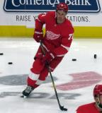 Dylan Larkin of the Detroit Red Wings skates through the neutral zone during pre-game warmups before a preseason game against the Boston Bruins.