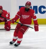Luke Witkowski of the Detroit Red Wings skates during pre-game warmups before a preseason game against the Boston Bruins.
