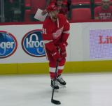 Luke Glendening of the Detroit Red Wings skates near the boards during pre-game warmups before a preseason game against the Boston Bruins.