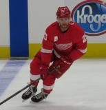 Mike Green of the Detroit Red Wings skates at the blue line during pre-game warmups before a preseason game against the Boston Bruins.