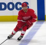 Nick Jensen of the Detroit Red Wings skates across the blue line during pre-game warmups before a preseason game against the Boston Bruins.