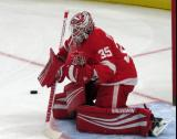 Jimmy Howard of the Detroit Red Wings faces a shot during pre-game warmups before a preseason game against the Boston Bruins.