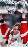 Vladimir Konstantinov raises the Stanley Cup after the 1997 Finals.