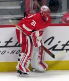 Jared Coreau of the Detroit Red Wings crouches in the corner during pre-game warmups before a preseason game against the Boston Bruins.