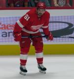 Xavier Ouellet of the Detroit Red Wings crouches near the boards during pre-game warmups before a preseason game against the Boston Bruins.