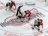 Gustav Nyquist, Riley Sheahan, and Tomas Tatar of the Detroit Red Wings take the opening faceoff of a preseason game against Matt Beleksey, Sean Kuraly, and Danton Heinen of the Boston Bruins.