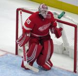 Jimmy Howard of the Detroit Red Wings moves across his crease during a preseason game against the Boston Bruins.