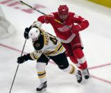 P.A. Parenteau of the Detroit Red Wings tries to get around Matt Grzelcyk of the Boston Bruins during a preseason game.