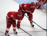 Tomas Tatar and Xavier Ouellet of the Detroit Red Wings get set for a faceoff during a preseason game against the Boston Bruins.