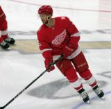 Nick Jensen of the Detroit Red Wings skates in the neutral zone during pre-game warmups before their home opener against the Minnesota Wild.