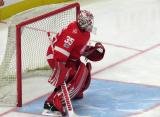 Jimmy Howard of the Detroit Red Wings gets set in his crease during pre-game warmups before their home opener against the Minnesota Wild.
