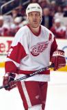 Brendan Shanahan gives a sideways glance to something off-camera as he skates across the ice.