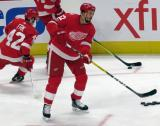 Jonathan Ericsson of the Detroit Red Wings looks to make a pass during pre-game warmups before their home opener against the Minnesota Wild.