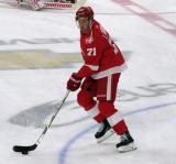 Dylan Larkin of the Detroit Red Wings skates near center ice during pre-game warmups before their home opener against the Minnesota Wild.