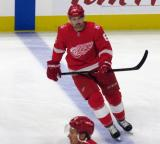Xavier Ouellet of the Detroit Red Wings skates at the blue line during pre-game warmups before their home opener against the Minnesota Wild.