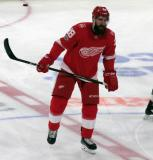 Luke Witkowski of the Detroit Red Wings skates at center ice during pre-game warmups before their home opener against the Minnesota Wild.