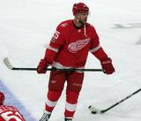 Mike Green of the Detroit Red Wings skates at the blue line during pre-game warmups before their home opener against the Minnesota Wild.