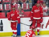 Tomas Tatar and Anthony Mantha of the Detroit Red Wings stand at the boards during pre-game warmups before their home opener against the Minnesota Wild.