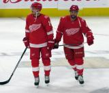 Gustav Nyquist and Luke Glendening of the Detroit Red Wings skate in the neutral zone during pre-game warmups before their home opener against the Minnesota Wild.