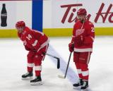 Gustav Nyquist and Mike Green of the Detroit Red Wings stand near the blue line during pre-game warmups before their home opener against the Minnesota Wild.