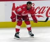 Henrik Zetterberg of the Detroit Red Wings crouches near the boards during pre-game warmups before their home opener against the Minnesota Wild.
