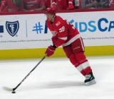 Anthony Mantha of the Detroit Red Wings carries a puck during pre-game warmups before their home opener against the Minnesota Wild.