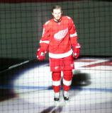 Gustav Nyquist of the Detroit Red Wings skates onto the ice during player introductions at the start of the team's home opener against the Minnesota Wild.
