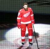 Luke Witkowski of the Detroit Red Wings skates onto the ice during player introductions at the start of the team's home opener against the Minnesota Wild.