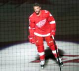 Luke Glendening of the Detroit Red Wings skates onto the ice during player introductions at the start of the team's home opener against the Minnesota Wild.