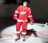 Darren Helm of the Detroit Red Wings skates onto the ice during player introductions at the start of the team's home opener against the Minnesota Wild.