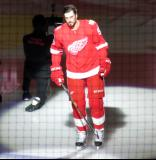 Jonathan Ericsson of the Detroit Red Wings skates onto the ice during player introductions at the start of the team's home opener against the Minnesota Wild.