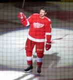 Xavier Ouellet of the Detroit Red Wings skates onto the ice during player introductions at the start of the team's home opener against the Minnesota Wild.