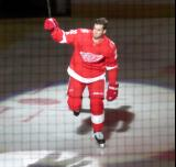 Dylan Larkin of the Detroit Red Wings skates onto the ice during player introductions at the start of the team's home opener against the Minnesota Wild.