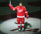 Henrik Zetterberg of the Detroit Red Wings skates onto the ice during player introductions at the start of the team's home opener against the Minnesota Wild.