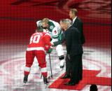 Henrik Zetterberg of the Detroit Red Wings and Mikko Koivu of the Minnesota Wild take a ceremonial faceoff to honor the opening of Little Caesars Arena, with the puck dropped by Red Wings greats Mickey Redmond and Nicklas Lidstrom and owner Christopher Ilitch.