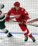 Darren Helm of the Detroit Red Wings skates through the neutral zone during a game against the Minnesota Wild.