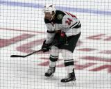 Matt Dumba of the Minnesota Wild gets set for a faceoff during a game against the Detroit Red Wings.