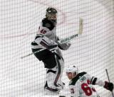 Devan Dubnyk of the Minnesota Wild heads to his bench for an extra attacker during a game against the Detroit Red Wings.