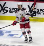 Robbie Russo of the Grand Rapids Griffins skates during pre-game warmups before his team's season-opening game against the Manitoba Moose.