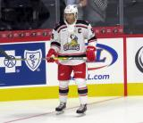 Matt Ford of the Grand Rapids Griffins stands near the boards during pre-game warmups before his team's season-opening game against the Manitoba Moose.
