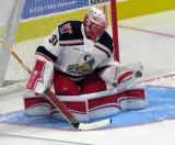 Jared Coreau of the Grand Rapids Griffins makes a glove save during pre-game warmups before his team's season-opening game against the Manitoba Moose.