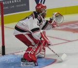 Tom McCollum of the Grand Rapids Griffins gets set to face a shot during pre-game warmups before his team's season-opening game against the Manitoba Moose.