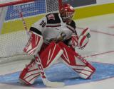 Tom McCollum of the Grand Rapids Griffins makes a glove save during pre-game warmups before his team's season-opening game against the Manitoba Moose.