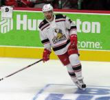 Axel Holmstrom of the Grand Rapids Griffins skates during pre-game warmups before his team's season-opening game against the Manitoba Moose.