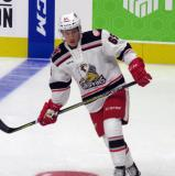 Dominik Shine of the Grand Rapids Griffins skates in the neutral zone during pre-game warmups before his team's season-opening game against the Manitoba Moose.