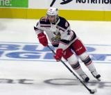 Matt Lorito of the Grand Rapids Griffins skates with a puck during pre-game warmups before his team's season-opening game against the Manitoba Moose.