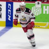 Axel Holmstrom of the Grand Rapids Griffins skates near the boards during pre-game warmups before his team's season-opening game against the Manitoba Moose.