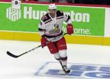 Colin Campbell of the Grand Rapids Griffins skates during pre-game warmups before his team's season-opening game against the Manitoba Moose.